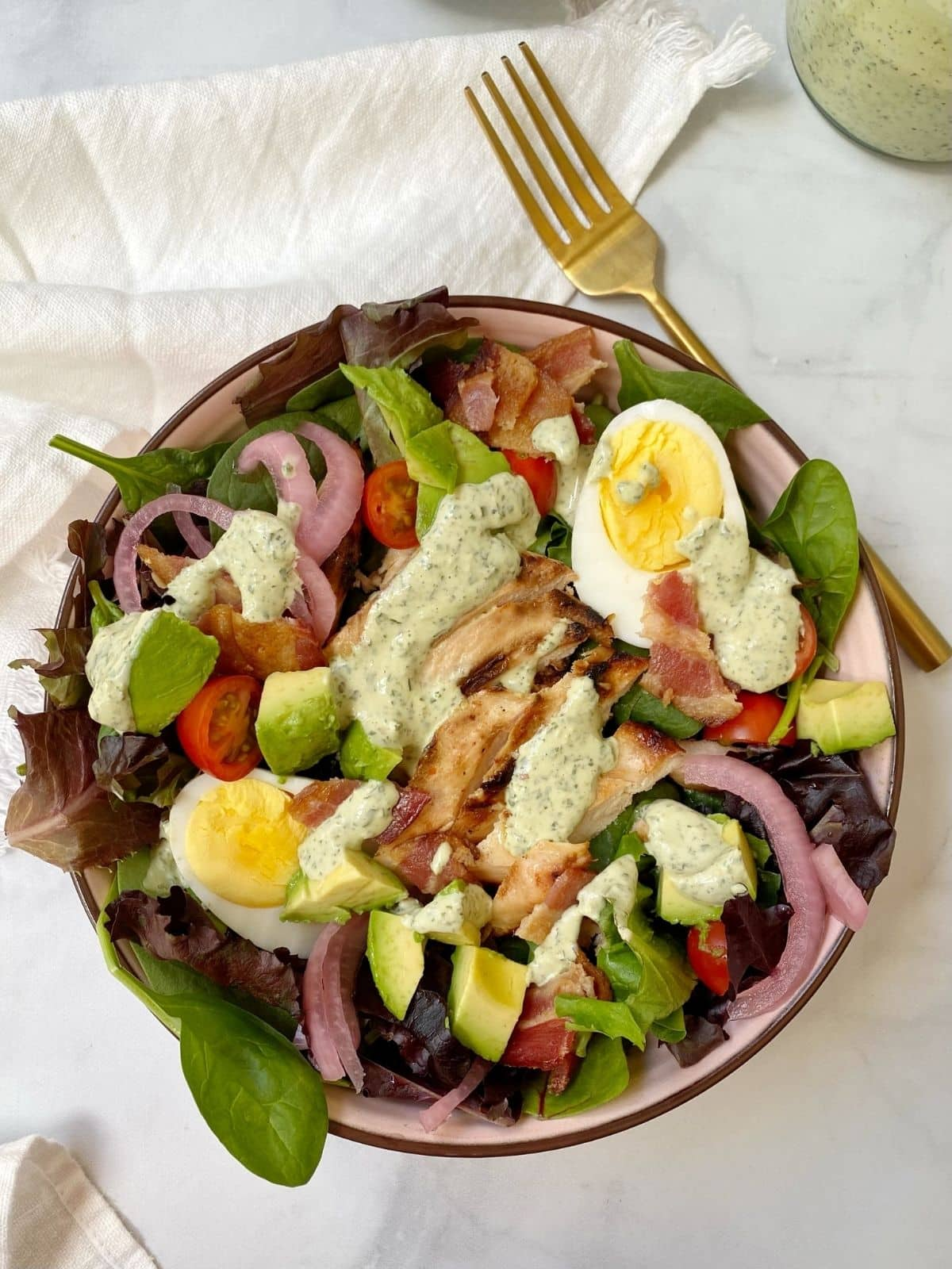 top down of green goddess cobb salad in a bowl.