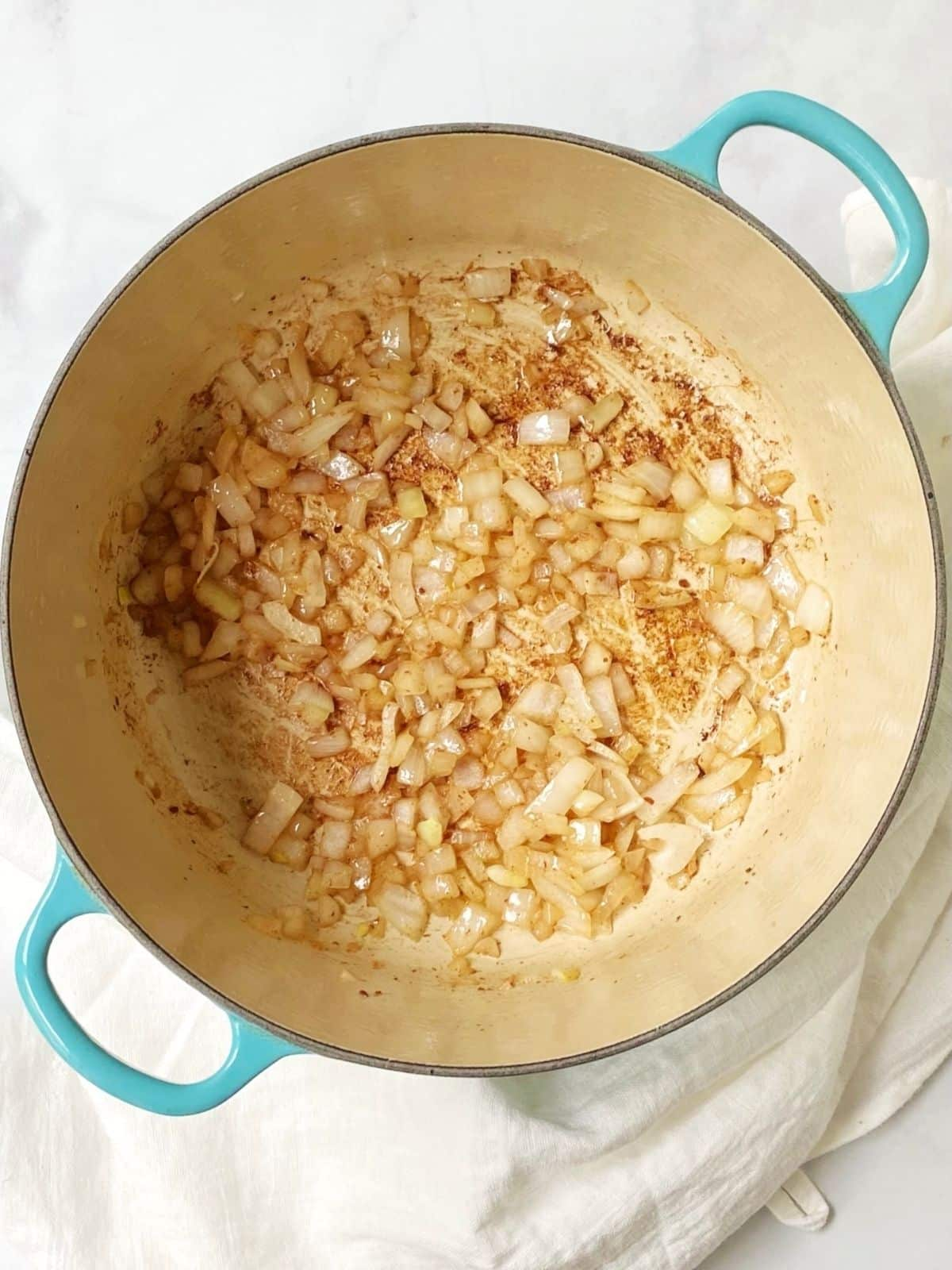 saute onions for potato gnocchi soup