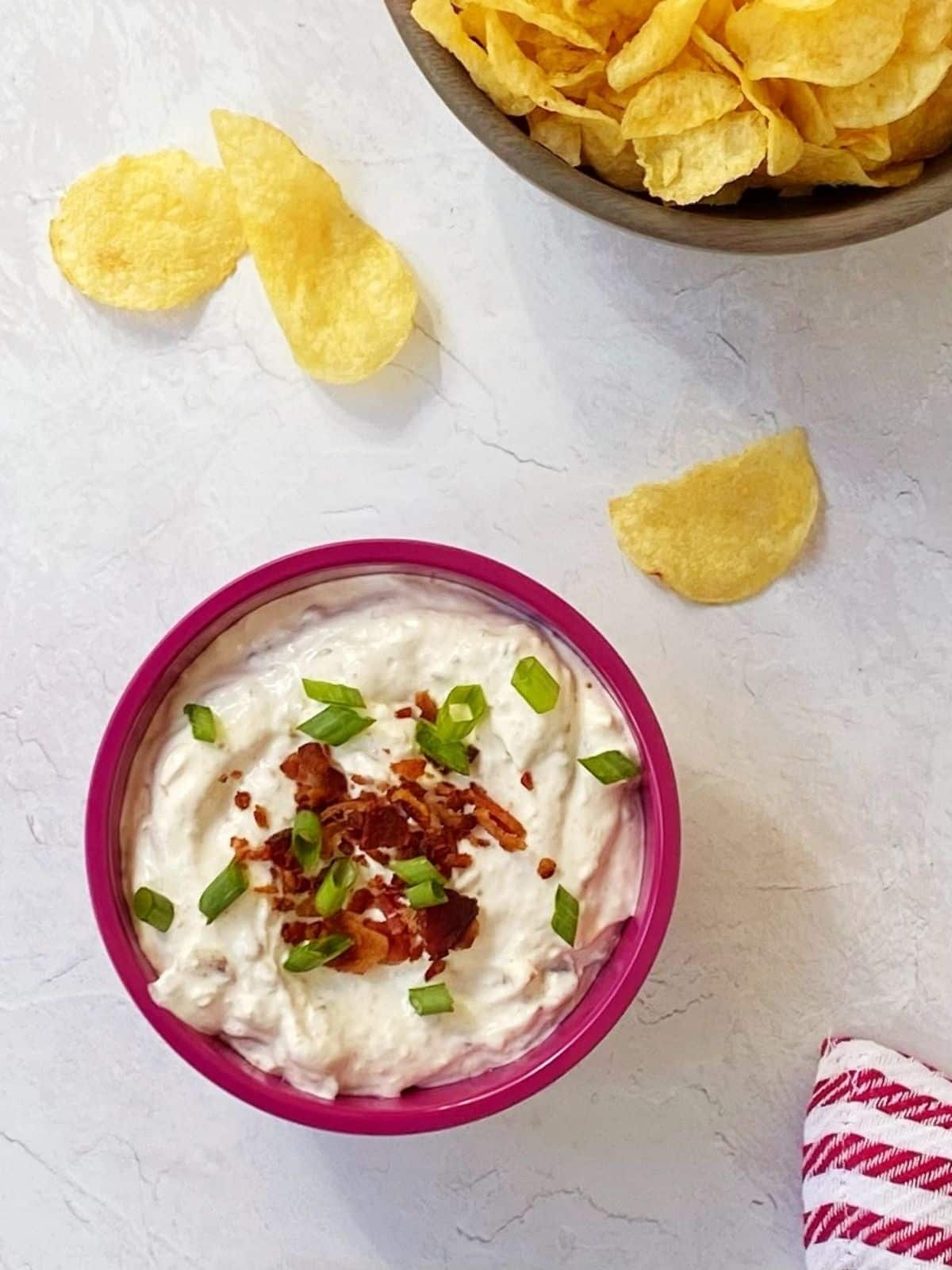 top down shot of bacon horseradish dip with chips