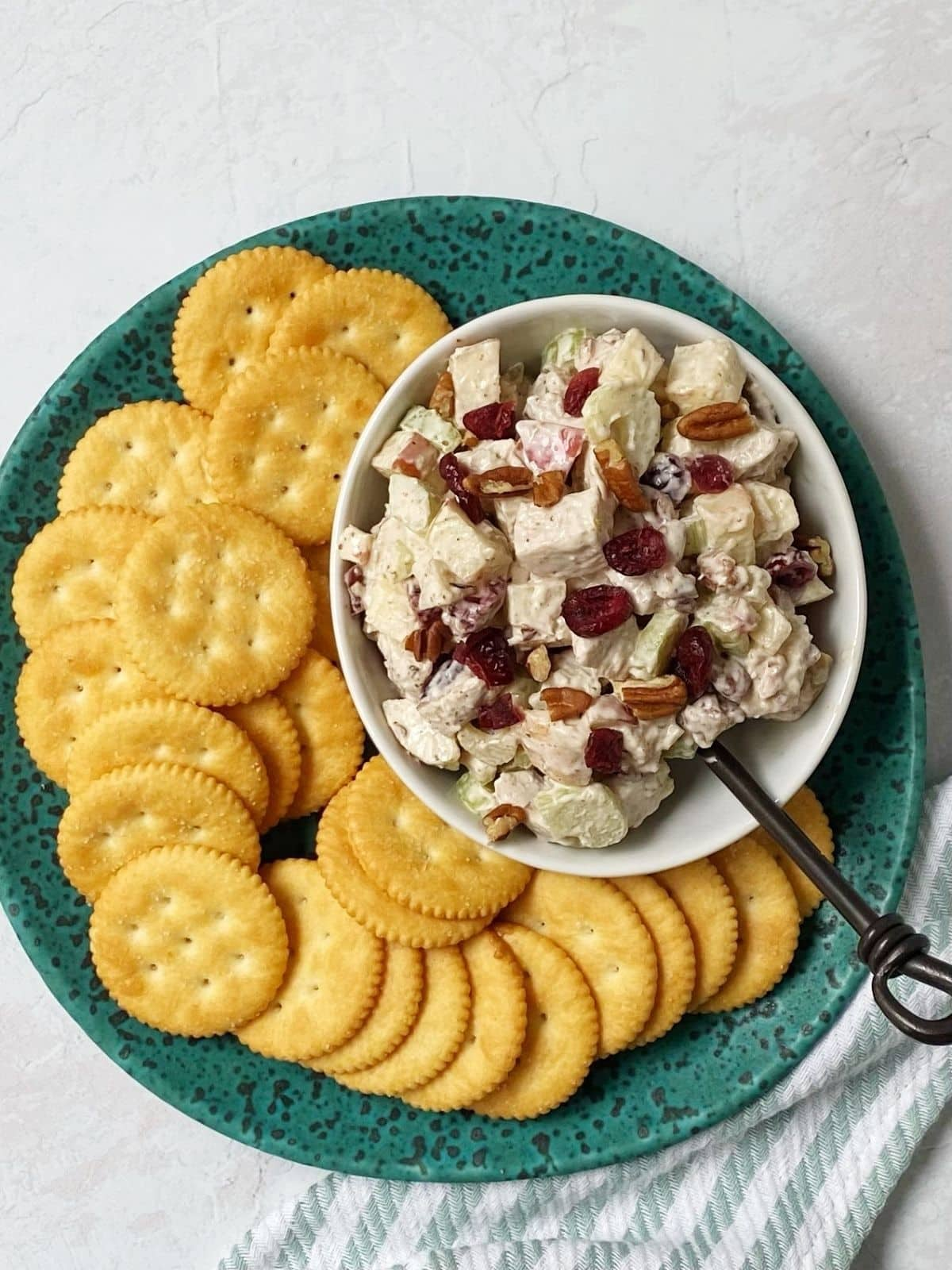 chicken salad with crackers on a plate.