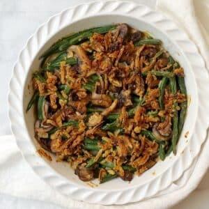 green bean casserole in white dish.